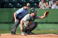 Home plate umpire Ryan Doherty and Beloit Snappers catcher Philip Pohl (12) during a game against the Clinton LumberKings on August 17, 2014 at Ashford University Field in Clinton, Iowa.  Clinton defeated Beloit 4-3.  (Mike Janes/Four Seam Images)