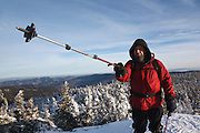 Appalachian Trail - A winter hiker stands on the summit of Mount Moriah during the winter months in the White Mountains, New Hampshire.