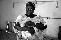 Roma 2000.Rebibbia, Carcere Femminile.Detenuta lavorante, alle sezione allevamento pollame.Rome 2000.Rebibbia Prison Women.Worker held, poultry farm.