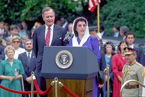 Washington, D.C. - (FILE) -- Prime Minister Benazir Bhutto of Pakistan, right, makes remarks after being welcomed to the White House for a State Visit by United States President George H.W. Bush, left, in Washington, D.C. on Tuesday, June 6, 1989.  Bhutto was assassinated in Rawalpindi, Pakistan on Thursday, December 27, 2007 after appearing at a campaign rally there..Credit: Ron Sachs / CNP