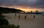 Young locals enjoy a game of volleyball on the municipal beach at Onna Village, Okinawa Prefecture, Japan, on Saturday, June 23, 2012. Photographer: Robert Gilhooly