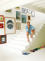 Designer Sig Bergamin on the steps in the entrance hall of his beach house