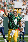 Quarterback Brett Favre #4 of the Green Bay Packers celebrates a touchdown pass during an NFL football game against the San Diego Chargers at Lambeau Field on September 23, 2007 in Green Bay, Wisconsin. The Packers beat the Chargers 31-24. (Photo by David Stluka)