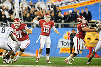 Jan. 1, 2011; Glendale, AZ, USA; Oklahoma Sooners quarterback (12) Landry Jones throws a pass in the second quarter against the Connecticut Huskies in the 2011 Fiesta Bowl at University of Phoenix Stadium. Mandatory Credit: Mark J. Rebilas-.