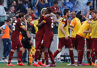 Calcio, Serie A: Lazio vs Roma. Roma, stadio Olimpico, 25 maggio 2015.<br /> Roma's Mapou Yanga-Mbiwa, center, celebrates with teammates after scoring the winning goal during the Italian Serie A football match between Lazio and Roma at Rome's Olympic stadium, 25 May 2015.Roma won 2-1.<br /> UPDATE IMAGES PRESS/Riccardo De Luca