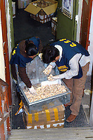 Rome 3 December 2007.Italien policemen of the Forest Guard employee to control of  international trade of plant's  and animals species protected  with agents of the Financial police seized  material from protected species in a  somali's store of district Equilino  .A box full of Lion's teeth
