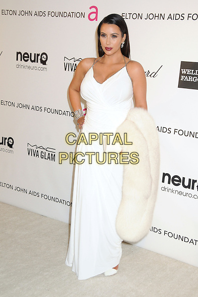 Kim Kardashian.21st Annual Elton John Academy Awards Viewing Party held at West Hollywood Park, West Hollywood, California, USA..February 24th, 2013.oscars full length white sleeveless dress hand on hip carrying fur pregnant halterneck .CAP/ADM/BP.©Byron Purvis/AdMedia/Capital Pictures.