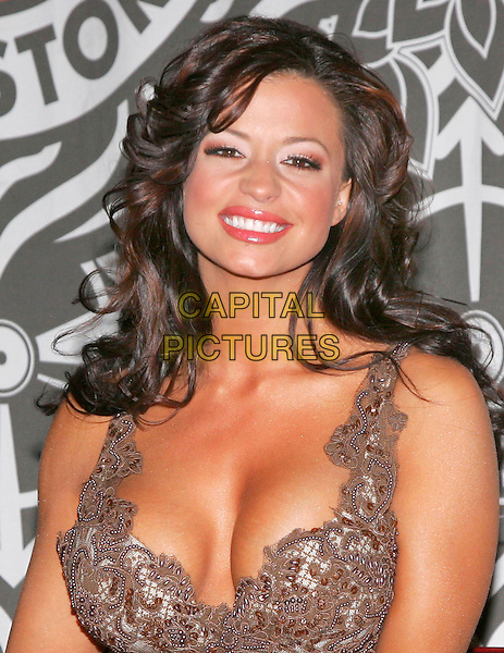 CANDICE MICHELLE.Signs copies of the April 2006 issue of Playboy in New York, NY, USA.  She is on the cover and has a spread in the magazine.  .March 9th, 2006.Photo: Jackson Lee/Admedia/Capital Pictures.Ref: JL/ADM.headshot portrait cleavage plunging neckline.www.capitalpictures.com.sales@capitalpictures.com.© Capital Pictures.
