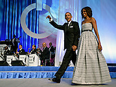 United States President Barack Obama  and first lady Michelle Obama arrive on stage for the Congressional Black Caucus Foundation Annual Phoenix Awards dinner, September 21, 2013, Washington, DC. The CBC's annual conference brings together activists, politicians and business leaders to discuss public policy impacting black communities in America and abroad.       <br /> Credit: Mike Theiler / Pool via CNP
