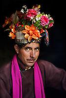 Ladakh, India 2006 . Man wearing flowers, Dha-Hanu, Ladakh, India, 2006