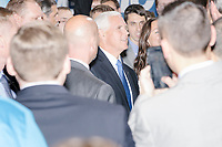 Vice President Mike Pence greets people after speaking at a Politics and Eggs event at Saint Anselm College's Institute of Politics in Manchester, New Hampshire, on Thu., November 7, 2019. Pence traveled to New Hampshire as a surrogate for Donald Trump to file required paperwork for the president to get on the New Hampshire presidential primary ballot in 2020.