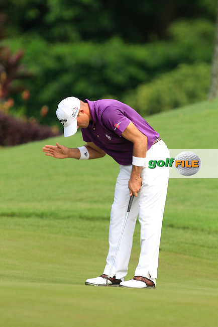 Jonathan Byrd (USA) on the 6th green during Round 4 of the CIMB Classic in the Kuala Lumpur Golf &amp; Country Club on Sunday 2nd November 2014.<br /> Picture:  Thos Caffrey / www.golffile.ie