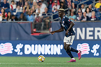 FOXBOROUGH, MA - AUGUST 31: Wilfried Zahibo #23 of New England Revolution dribbles at midfield during a game between Toronto FC and New England Revolution at Gillette Stadium on August 31, 2019 in Foxborough, Massachusetts.