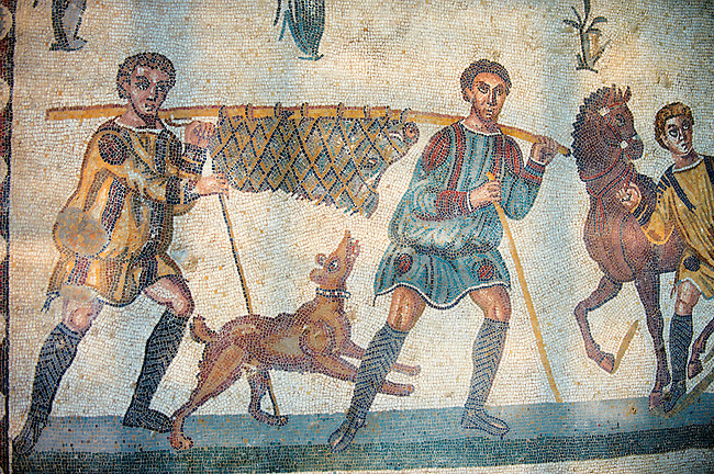 Hunters carrying a wild boar from the Room of The Small Hunt, no 25 - . Roman mosaics at the Villa Romana del Casale which containis the richest, largest and most complex collection of Roman mosaics in the world. Constructed  in the first quarter of the 4th century AD. Sicily, Italy. A UNESCO World Heritage Site.