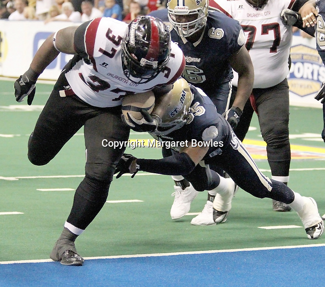 05 June 2010: Oklahoma City fullback Chad Cook #37 powers into the endzone late in the fourth quarter to bring the Yard Dawgz within 2 points of tying the score.  The Tampa Bay Storm defeated the Oklahoma City Yard Dawgz 50-48 at the St. Pete Forum in Tampa, Florida