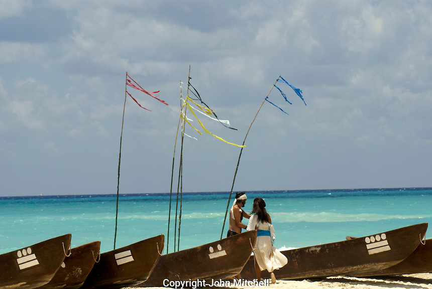 Traditional Mayan dugout canoes and performers (freed slave Gonzalo Guerrero and the Mayan princess that he later married) on the beach at Playa del Carmen or Xamanha, Sacred Mayan Journey 2011 event, Riviera Maya, Quintana Roo, Mexico.