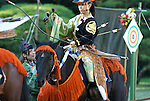 Nov 3 2009- Tokyo, Japan- A Yabusame horse-back archer retrives her arrows at an event at Meiji shrine during celebrations for Cuture Day...