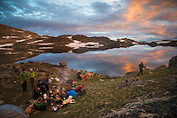 A group of campers relaxes near Upper Aero Lake in the Absaroka-Beartooth Wilderness.