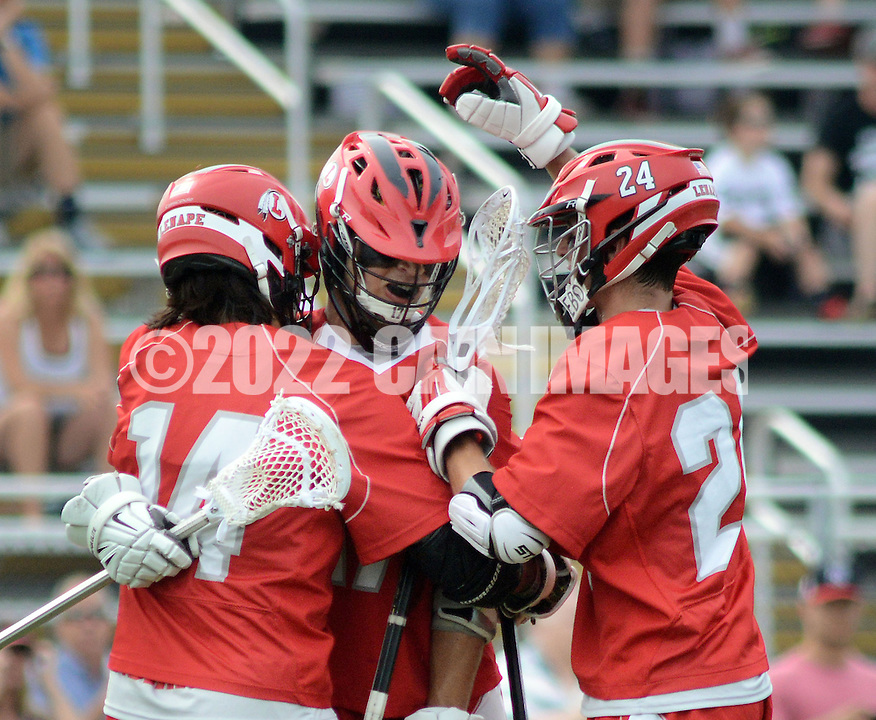 Lenape's Anthony Brunetti (C) is congratulated by teammates Liam Baker #14 and Connor Wolfe #24 after scoring in the first quarter during the Group 4 state championship game at Hopewell Valley Central High School Thursday May 28, 2015 in Hopewell, New Jersey. Lenape lost to Bridgewater 16-8. (Photo by William Thomas Cain/Cain Images)