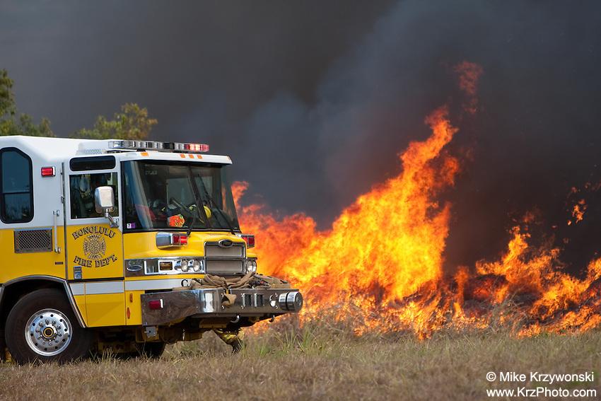 Fire engine next to brush fire in Waiala, Oahu, Hawaii