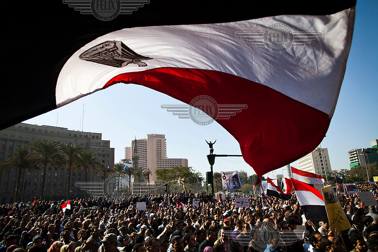 Protestors in Tahrir Square demanding the immediate transfer of power from Egypt's military rulers, SCAF (Supreme Council of the Armed Forces), to a civilian government.