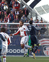 New England Revolution defender A.J. Soares (5) and Sporting Kansas City midfielder C.J. Sapong (17) battle for head ball.   In a Major League Soccer (MLS) match, Sporting Kansas City (blue) tied the New England Revolution (white), 0-0, at Gillette Stadium on March 23, 2013.