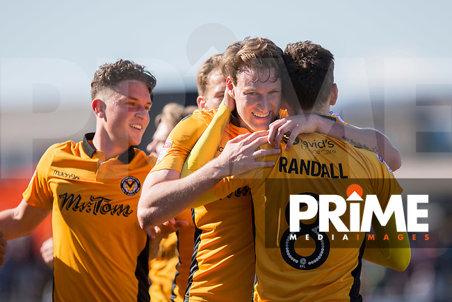 Ryan Bird of Newport County (centre) celebrates scoring his side's first goal with Mark Randall during the Sky Bet League 2 match between Newport County and Accrington Stanley at Rodney Parade, Newport, Wales on 22 April 2017. Photo by Mark  Hawkins.