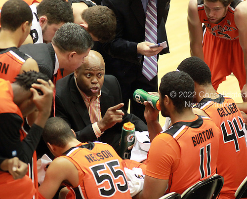 Head Coach Craig Robinson of the Oregon State University basketball team gives some pointers to his squad during their game against the Towson State University Tigers on the campus of Towson State University in Towson, Maryland, Saturday, November 26, 2011. Mr. Robinson is the older brother of first lady Michelle Obama..Credit: Martin Simon / Pool via CNP