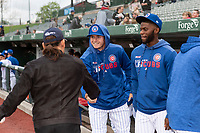 Actor Danny Trejo talks to Cole Roederer (7) and Delvin Zinn (3) before a Midwest League game between the South Bend Cubs and the Cedar Rapids Kernels at Four Winds Field on May 7, 2019 in South Bend, Indiana. (Zachary Lucy/Four Seam Images)