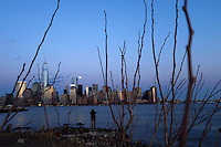 A man takes pictures of the full moon as it rises over New York City from a park in New Jersey. March 15, 2014. Photo by Eduardo Munoz Alvarez/VIEW