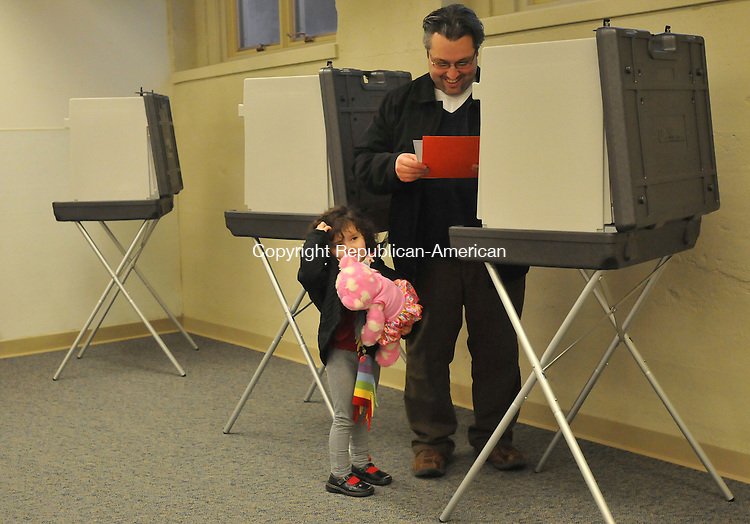 MIDDLEBURY, CT-02 MARCH 2009-030210IP02-Sophia Farias, 4, curls her hair with her finger as she waits for her father John Farias to vote on the referendum for improvements to town-wide radio communications systems at Shepardson Community Center in Middlebury on Tuesday.<br /> Irena Pastorello Republican-American