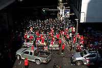 """Red Shirt"" protesters are met by Riot police in riot gear in Chidlom one of Bangkok's busy business areas in the city centre."