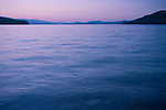 Idaho, Priest Lake, Nordman. Looking south across the calm evening waters in the last light of a summer day.
