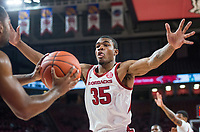 NWA Democrat-Gazette/BEN GOFF @NWABENGOFF <br /> Reggie Chaney of Arkansas defends as Tusculum inbounds the ball in the first half Friday, Oct. 26, 2018, during an exhibition game in Bud Walton Arena in Fayetteville.