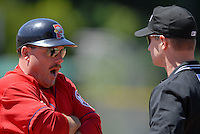 Portland Sea Dogs' manager Arnie Beyler shares his thoughts with first base umpire Jordan Ferrell during a game vs. the Trenton Thunder at Hadlock Field May 23, 2010 in Portland, ME (Photo by Ken Babbitt/Four Seam Images)
