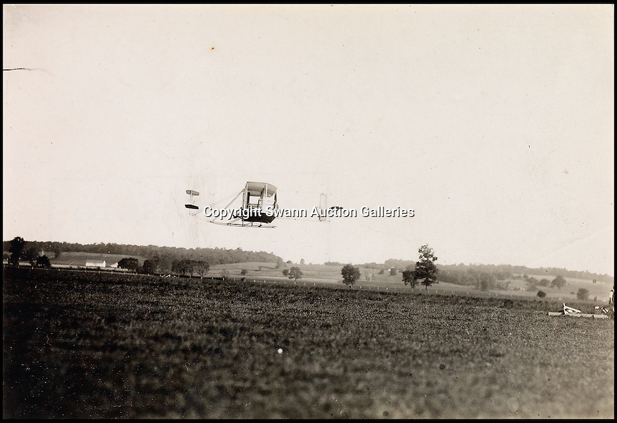 BNPS.co.uk (01202 558833)<br /> Pic: SwannAuctions/BNPS<br /> <br /> ***Please use full byline***<br /> <br /> Photograph by Orville Wright of the plane in flight.<br /> <br /> A fascinating archive of previously unseen photographs documenting the Wright Brothers' pioneering advances in early flight has come to light.<br /> <br /> The black and white photos chart Wilbur and Orville Wright's work developing their rudimentary aircraft in the years following their historic first powered flight in 1903.<br /> <br /> The collection was compiled by aviation enthusiast Walt Burton, who bought two albums of photos of the Wright Brothers from Frank Hermes, a businessman who paid the pair to fly his freight around.<br /> <br /> It expected to fetch upwards of £20,000 when it goes under the hammer at Swann Auction Galleries.