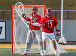 UAlbany Men's Lacrosse defeats Stony Brook on March 31 at Casey Stadium.  Stony Broook goalkeeper Michael Bollinger (#47) and defender Ryland Rees (#17).