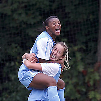 University of North Carolina midfielder Kelly McFarlane (11) celebrates her goal with University of North Carolina midfielder Crystal Dunn (19). The only goal of the game.  University of North Carolina (blue) defeated Boston College (white), 1-0, at Newton Campus Field, on October 13, 2013.