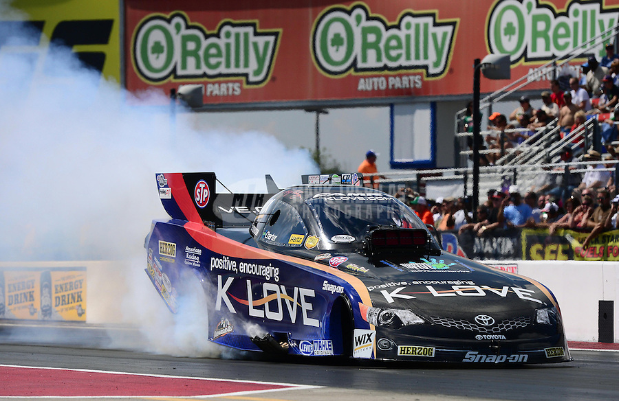 Sept. 15, 2012; Concord, NC, USA: NHRA funny car driver Tony Pedregon during qualifying for the O'Reilly Auto Parts Nationals at zMax Dragway. Mandatory Credit: Mark J. Rebilas-