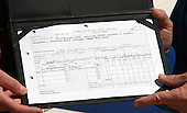 The XV-15 tilt rotor aircraft's final flight manifest is displayed as NASA and the U.S. Army transferred the vehicle to the National Air and Space Museum's new Steven F. Udvar-Hazy Center near Washington Dulles International Airport in Herndon, Virginia on September 16, 2003.  Tilt rotors are a unique type of aircraft that possess the take-off, hover and landing capabilities of a conventional helicopter with the range and speed of a turboprop aircraft.  Tilt rotor flight research began in the 1950s with the Bell XV-3 convertiplane.  NASA's Ames Research Center, Moffett Field, Calif., in partnership with the U.S. Army, developed design specifications for a new aircraft to demonstrate the viability of the tilt rotor concept.  After extensive ground, wind tunnel and simulator tests at Ames, the first of two XV-15s, built by Bell Helicopter Textron, took its maiden flight on May 3, 1977.  The success of the XV-15 has led to the development of the V-22 Osprey and the world's first civil tilt rotor, the nine-passenger Bell Agusta 609, now under development and scheduled for deliveries in 2007.  The National Air and Space Museum, comprised of the Udvar-Hazy Center, which is scheduled to open to the public on December 15, 2003, and the museum's building on the National Mall, .will be the largest air-and-space-museum complex in the world. .Credit: Ron Sachs / CNP