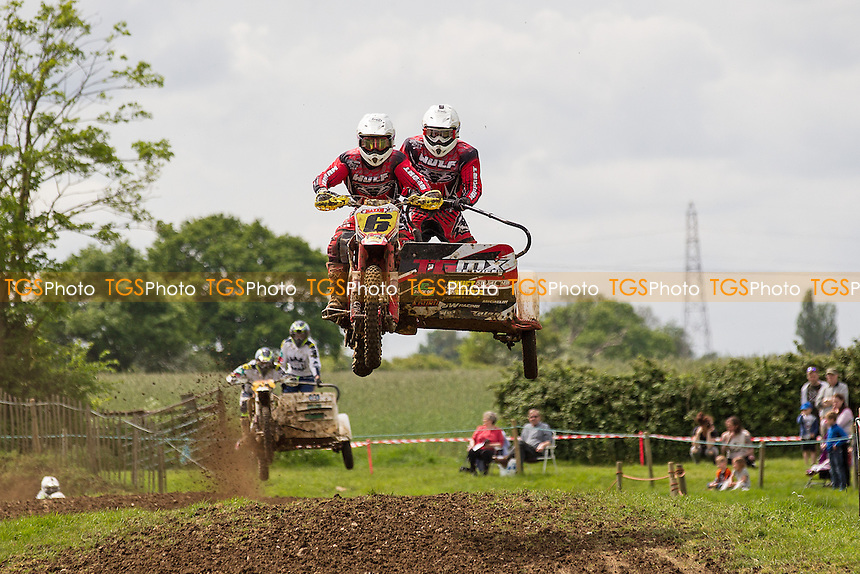 Tony Grahame and Harley Lloyd airborne in Moto 1 during ACU British Sidecar Cross Championship Round Three at Wattisfield Hall MX Track on 22nd May 2016
