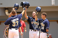 11 May 2008: Florida International first baseman Tyler Townsend (37) celebrates with teammates (left to right) left fielder John Petika (19), catcher Steven Stropp (29) and right fielder Raimy Fuentes (38) after hitting a three-run home run in the bottom of the fourth inning to give FIU a lead at University Park Stadium in Miami, Florida.
