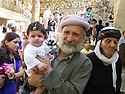 Iraq 2011 <br /> Baptism in Lalesh, the grand-father with his grand-daughter after the ceremony in a temple   <br /> Irak 2011 <br /> Bapteme au sanctuaire de Lalesh, grand-pere avec sa petite-fille apres la ceremonie