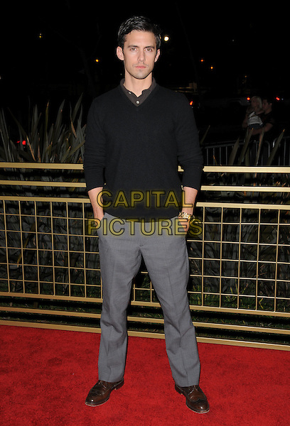 MILO VENTIMIGLIA.The LG Electronics launch of The Scarlet HD TV Series held at The Pacific Design Center in Beverly Hills, California, USA..April 28th, 2008                                           .full length black top sweater grey gray trousers hands in pockets .CAP/DVS.©Debbie VanStory/Capital Pictures.