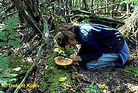 DT02-046z  Forest - girl collecting organisms from soil