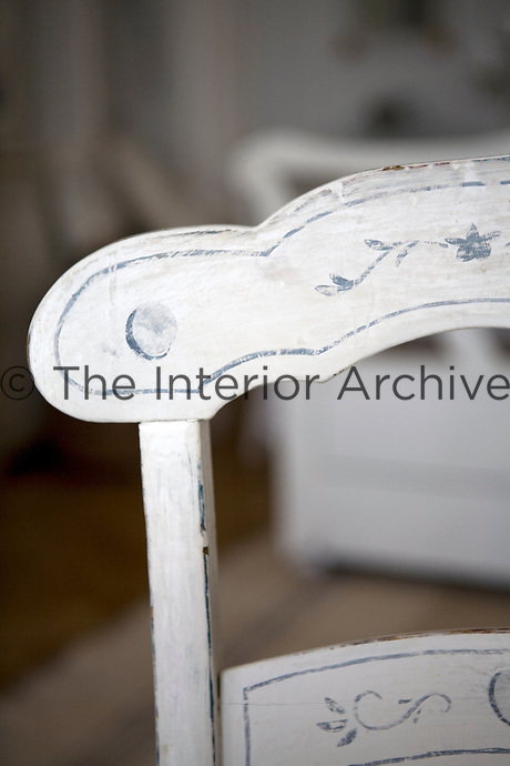Detail of a simple hand-painted wooden chair