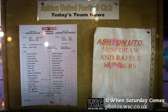Ashton United 6 Ramsbottom United 0, 12/01/2016. Hurst Cross stadium, Northern Premier League. Team lines and draw winning numbers posted in an office window before the fixture between Ashton United and Ramsbottom United in the Northern Premier League premier division. The match was played at Ashton's Hurst Cross stadium, the club's ground. The club was originally founded in 1878 as Hurst F.C. and by 1880 the club were playing at Hurst Cross, their current ground which makes their home one of the oldest football grounds in the world. Ashton won the match 6-0, watched by a crowd of 178. Photo by Colin McPherson.