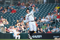 Charlotte Knights first baseman Matt Skole (12) settles under a pop fly during the game against the Indianapolis Indians at BB&T BallPark on May 26, 2018 in Charlotte, North Carolina. The Indians defeated the Knights 6-2.  (Brian Westerholt/Four Seam Images)