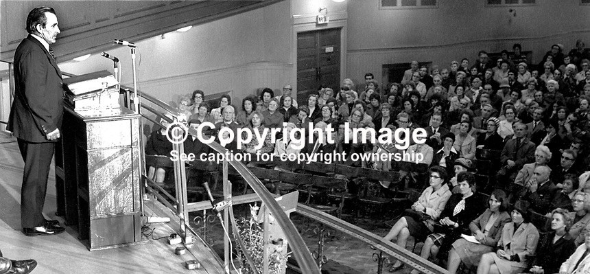 Peace Movement meeting in the Grosvenor Hall, Belfast, N Ireland, being addressed by Harry Murray, former prominent member, Ulster Workers' Council, 11th September 1974. Also on the platform with him were Canon Padraig Murphy, a Roman Catholic priest from West Belfast and representatives of the Bogside Peace Committee, Londonderry. 197409110488<br />