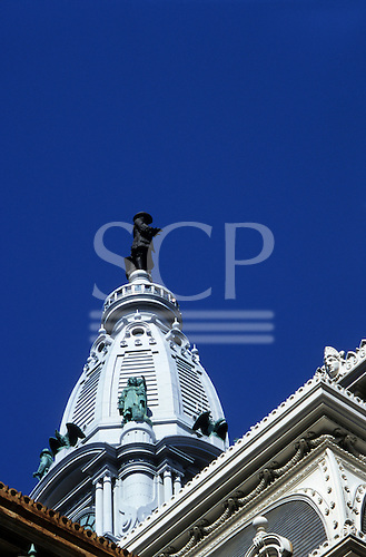 Philadelphia, USA. View up at historic City Hall with tower topped by huge statue of William Penn.